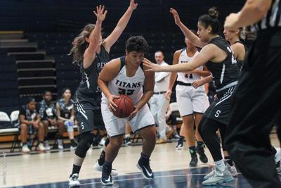 Women's Basketball: Fourth-Quarter Comeback Pushes Titans Over Wolverines
