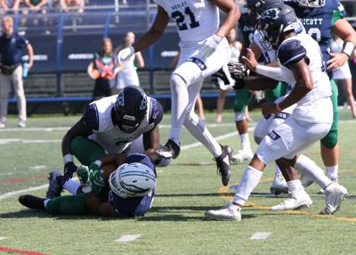Shymere Vessels completes a tackle against Endicott