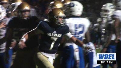 Salesianum's Dylan Mooney celebrates after scoring a touchdown against Dover