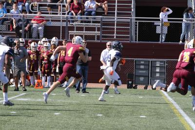 Wesley RB Marcellus Pack runs for a touchdown against Salisbury