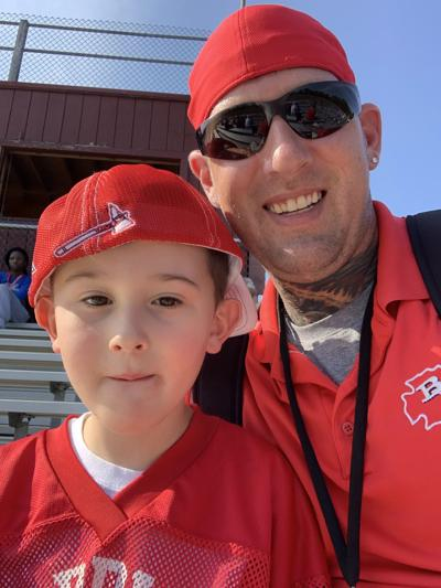 Neal McGinnes and his son Austin