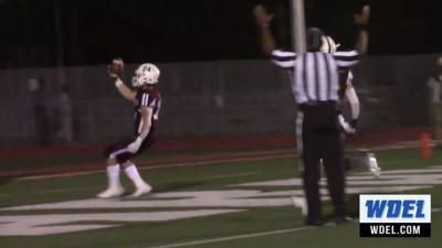 Caravel's Ethan Potter scores a touchdown against Caesar Rodney