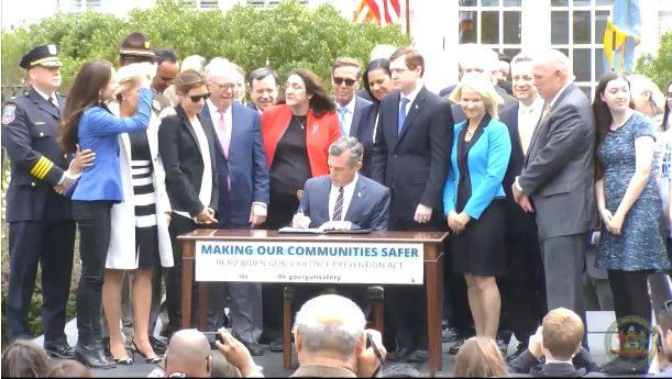 Gov John Carney signs the gun violence prevention act