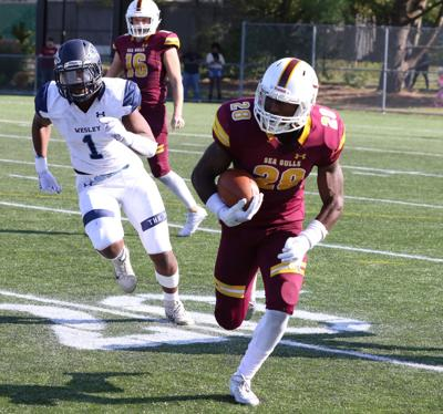 Salisbury's Shamar Gray rushes past Wesley's Tommy Tanner during the Gulls win in the Route 13 Rivalry