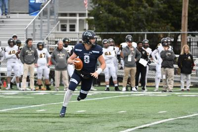 Drew Fry prepares to throw a pass against Framingham State