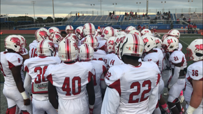 Smyrna huddles before their game at Dover in 2019