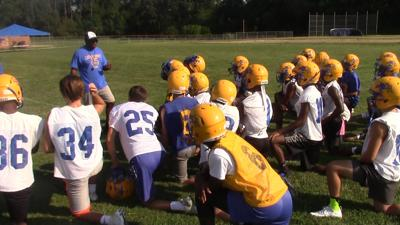 Caesar Rodney meets with their coaches before their first practice of the 2018 season