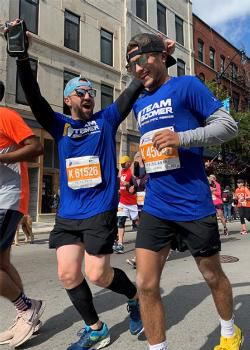 Michael Davis (right) runs the 2019 Chicago Marathon with his training partner Jay Asparro