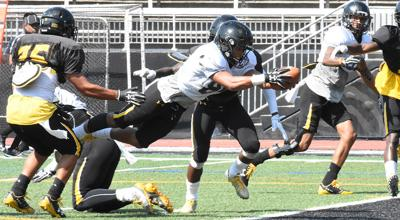 Shane Leatherbury scores a touchdown during practice for Towson
