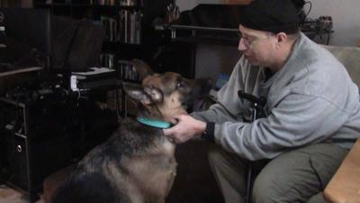 Frank Bicking and his service dog Beauty