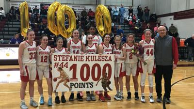 Conrad's Stefanie Kulesza (44) celebrates her 1,000th career point with her teammates at the Diamond State Classic