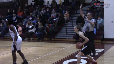 Referee Mark Moser works a game between Ursuline and Caravel
