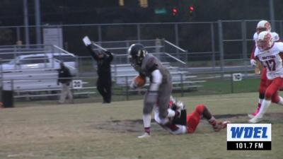 Sussex Tech's K.J. Custis runs through an attempted Smyrna tackle during a touchdown run