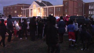 Friends of the family involved in the fatal crash at the C&D Canal Sunday hold a candlelight vigil