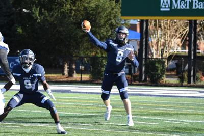 Drew Fry throws a pass against Christopher Newport
