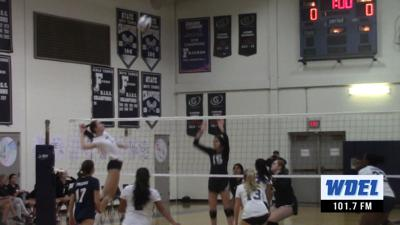 Wilmington Friends' Dani Nathan hits a kill against Wilmington Christian