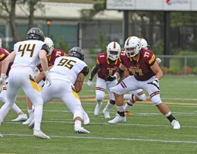 Former Milford lineman Tyler Norwood (77) throwing a block for Salisbury