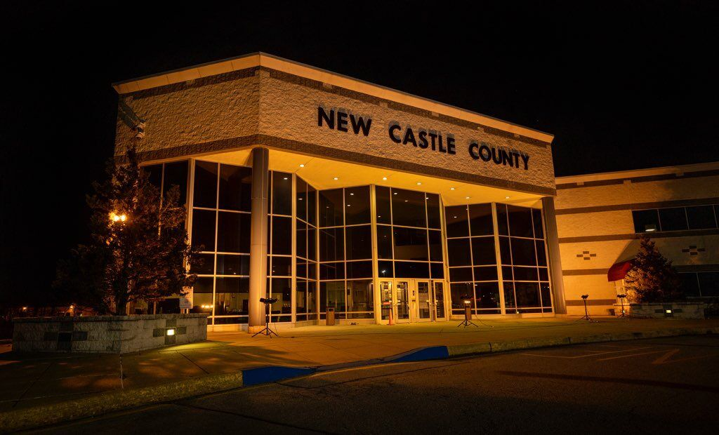New Castle County Government Building illuminated during a COVID-19 memorial
