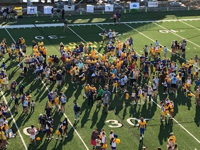 DFRC Blue-Gold Football Game participants meet with their Hand-and-Hand Buddies before the 2019 Game