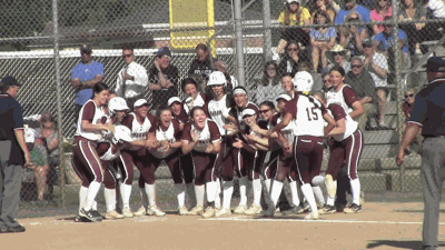 Caravel celebrates after Natalie Paoli's home run against Wilmington Charter