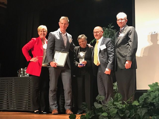 Bebe Coker being given the John H. Taylor Educational Leadership Award