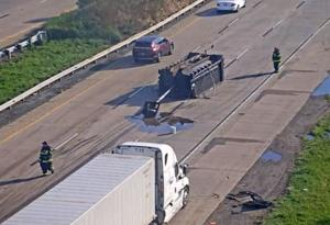 Dump truck hits I-495 overpass; bogs traffic down for hours
