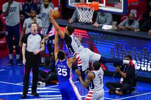 Without Embiid, 76ers roll past Wizards and into 2nd round