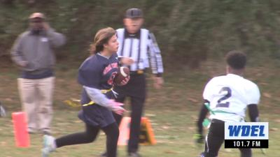 Newark Charter's Casey Wilson rushes for a first down against Delcastle in a Unified Flag Football game