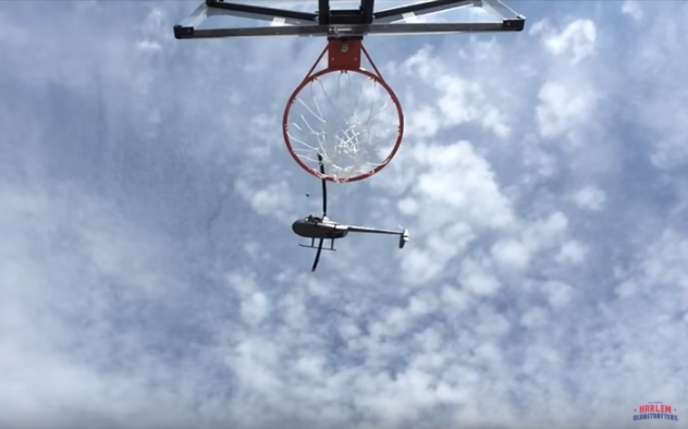 Harlem Globetrotter Drains Absurd 210-Foot Trick Shot From Helicopter