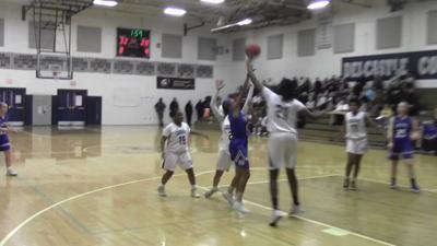 Delcastle's Emani Lucas-Davis blocks a shot against Wilmington Charter