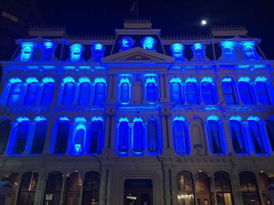 Grand Opera House lights up blue to honor first responders