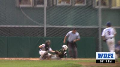 Newark National catcher Mark Spoor tags out a Lower Sussex runner during the 2019 Delaware Little League State Tournament