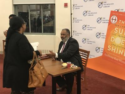 """Anthony Ray Hinton signs his book """"The Sun Does Shine"""" at the Wilmington Public Library"""