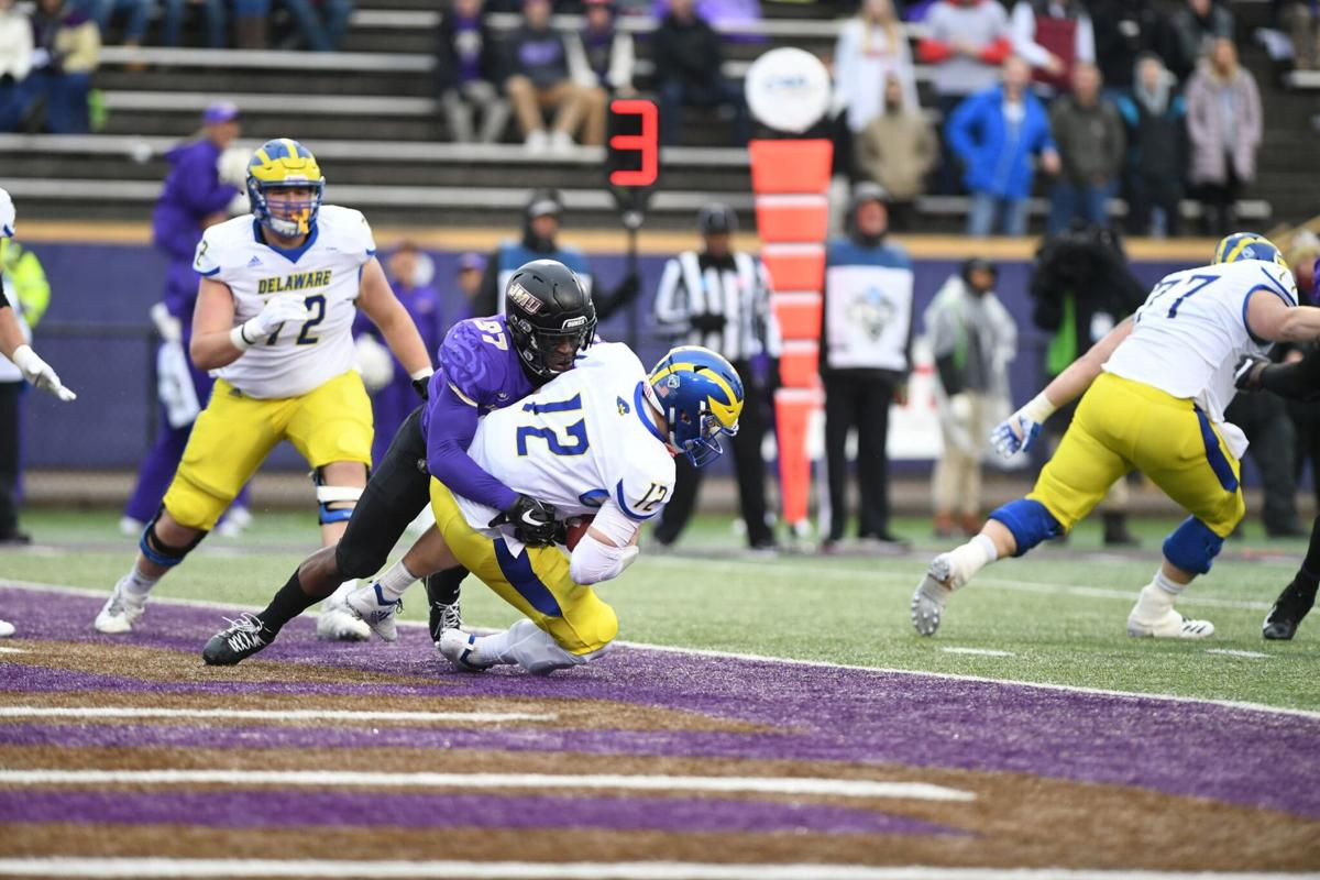 Delaware's Pat Kehoe is sacked by James Madison's John Daka for a safety