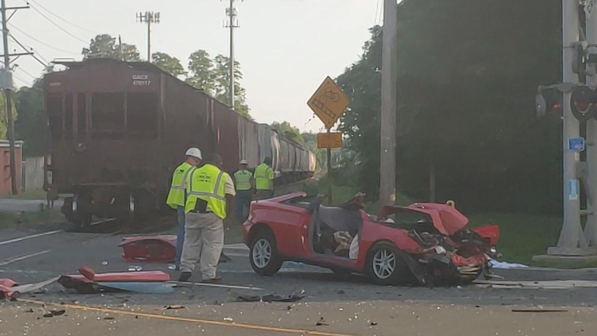 Norfolk Southern employees investigate a crash in New Castle on June 7, 2021