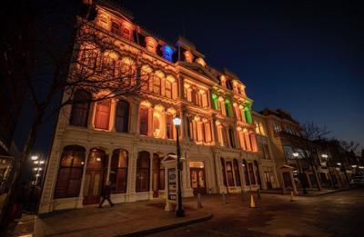 The Grand Opera House illuminated during COVID-19 Memorial