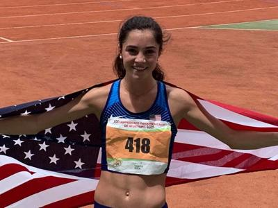 Lydia Olivere poses after winning the gold at the U20 Pan Am Games 3,000-meter steeplechase