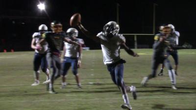 DMA's Corahn Alleyne scores a touchdown at Saint Mark's