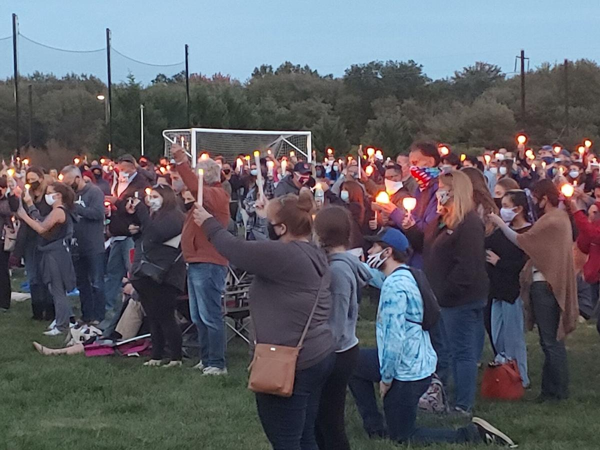 A candlelight vigil is held for Madison Sparrow, a Newark Charter student, on October 9, 2020