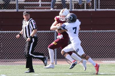 Wesley's Isiah Mitchell makes a tackle against Salisbury