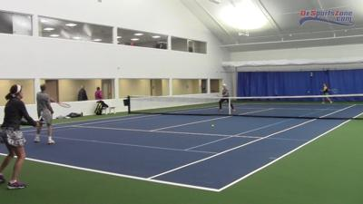 Players enjoy a doubles match indoor the Delcastle Tennis Center's indoor facility