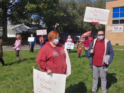 Red Clay community members protest outside the district's office over the reopening plan