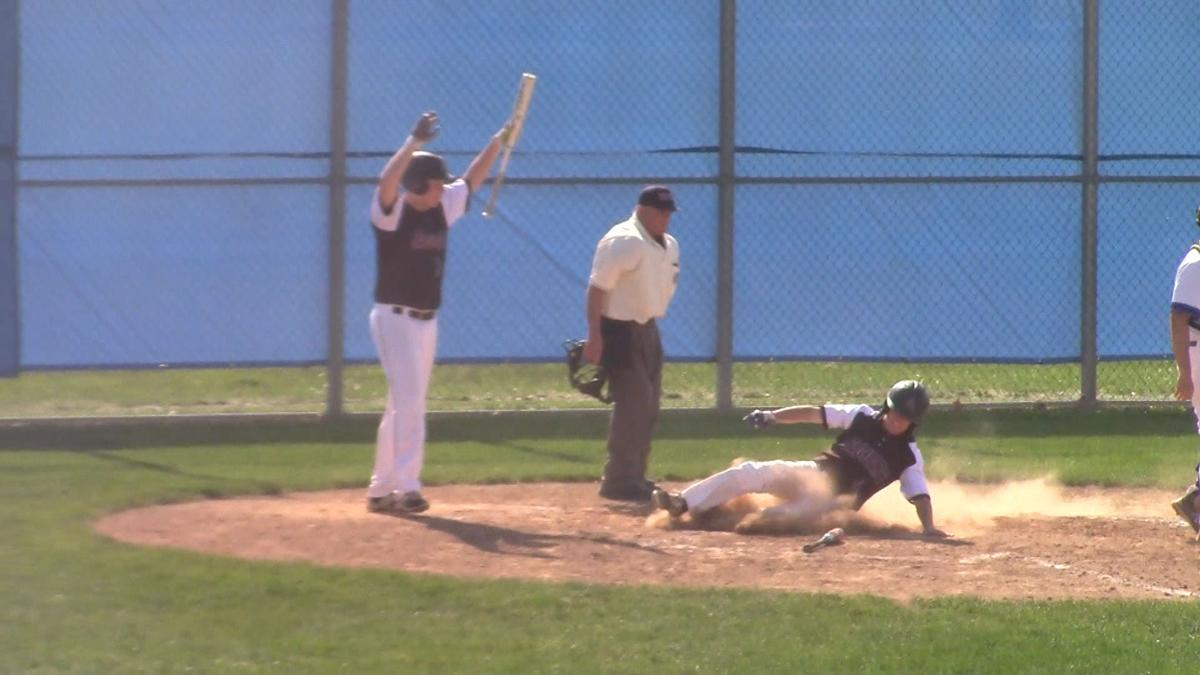 Appoquinimink's Mason Keene slides home with a run at Middletown