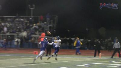 Sussex Central's Dom Smith catches a touchdown pass in a state semifinal victory over Dover