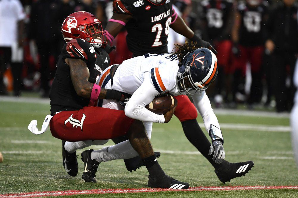Virginia quarterback Bryce Perkins (3) is brought down by Louisville linebacker C.J. Avery