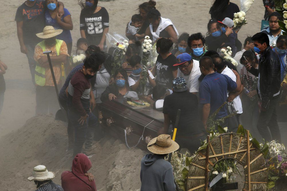 Relatives bury loved one at Valle de Chalco Municipal Cemetery in Mexico City