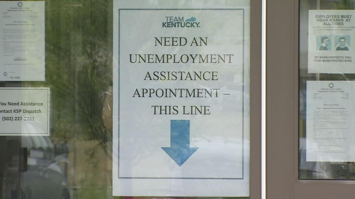 Signs directing people inside for unemployment claims