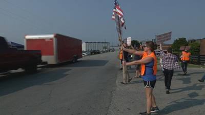 Heaven Hill Strikers hold signs