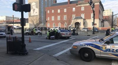 5 people hurt in 2-car crash downtown including a pedestrian