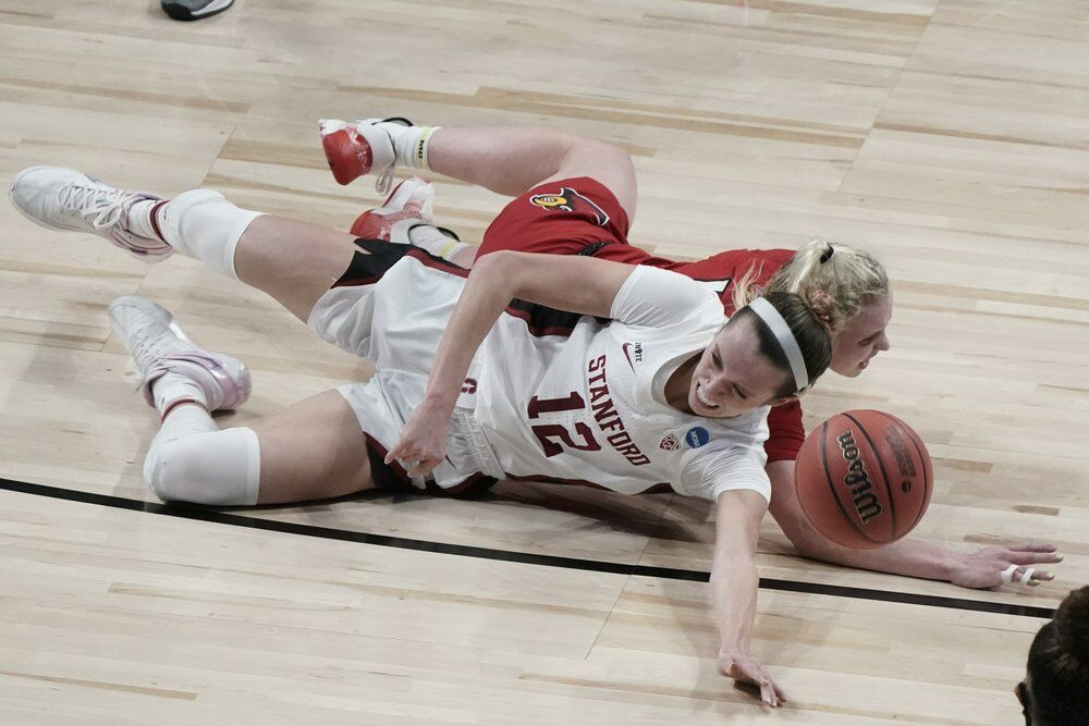 Stanford's Lexie Hull and Louisville's Hailey Van Lith go after a loose ball